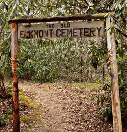photo shows the wooden arch entrance of elkmont cemetery