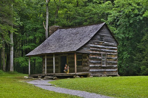 photo shows an old cabin in cades cove