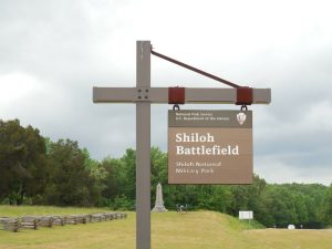 photo shows a wooden sign from the national parks service that says 'shiloh battlefield' in white paint