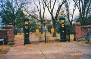 photo shows black iron gates leading to the shiloh national cemetery